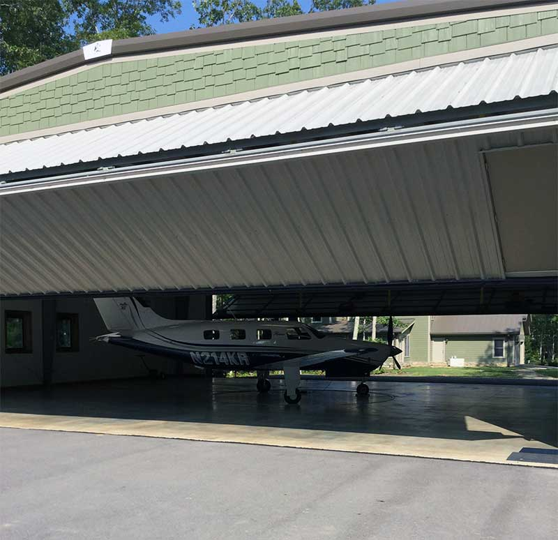 The Big South Fork Airpark taxiway leads right into Karl Rogers' vacation and getaway home 60 x 50-foot hangar in Oneida, Tenn.